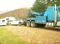 Horse trailer and truck being towed